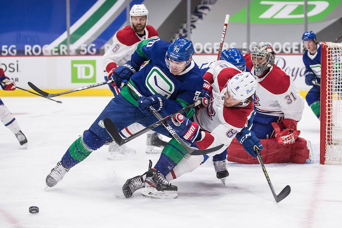 Vancouver Canucks' Tanner Pearson (70) and Montreal Canadiens' Ben Chiarot (8) vie for the puck as goalie Carey Price and Shea Weber (6) watch during the second period of an NHL hockey game in Vancouver, on Saturday, Jan. 23, 2021. THE CANADIAN PRESS/Darryl Dyck