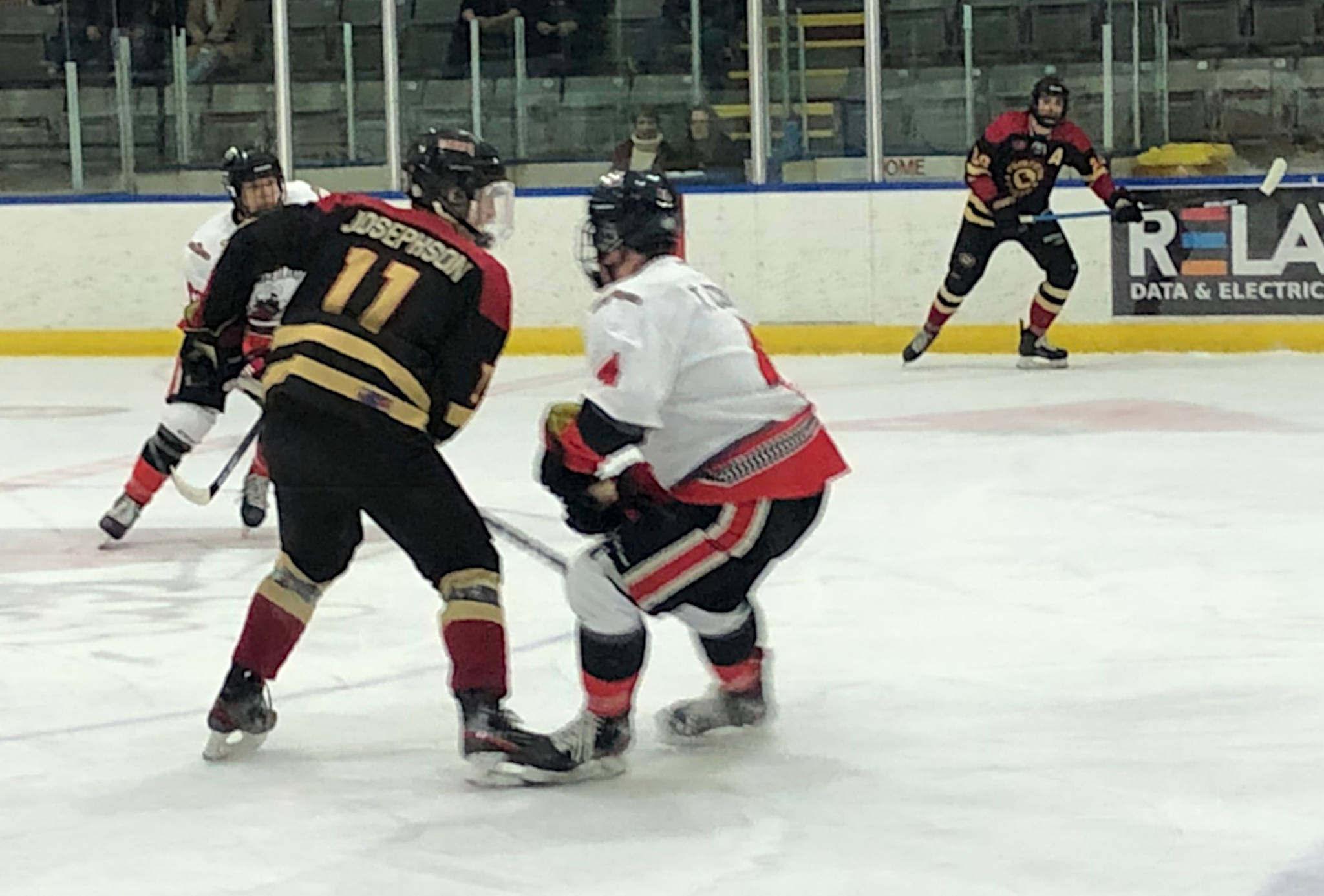Terrance Josephson of the Princeton Posse, at left, and Tyson Conroy of the Summerland Steam clash during a Junior B hockey game at the Summerland Arena in the early spring of 2020. (John Arendt - Summerland Review)