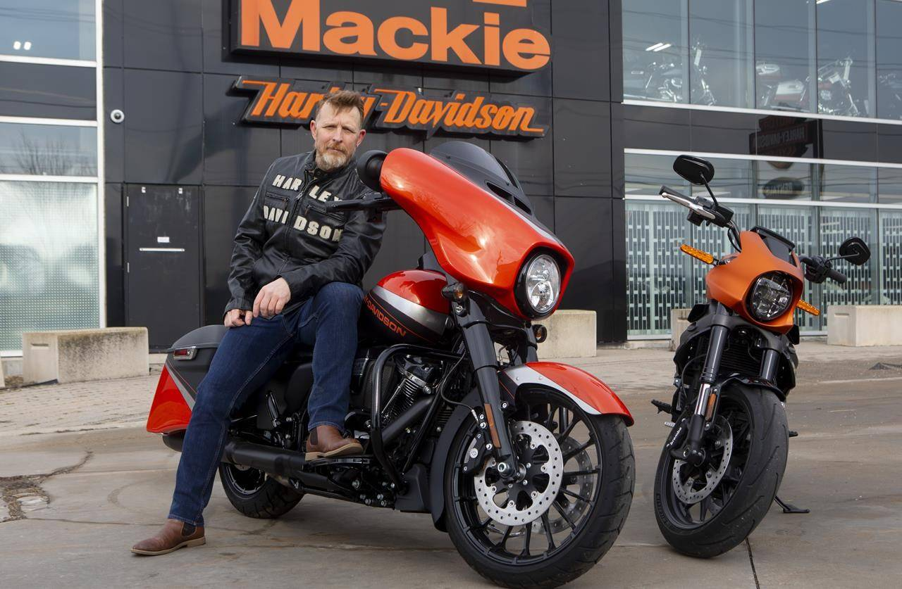 Andre Mazerolle sits on a Harley-Davidson FLHXS -Street Glide Special motorcycle at Mackie Harley-Davidson in Oshawa on Friday January 15, 2021. Mazerolle was laid off from his marketing job during the pandemic and has since made a big switch to selling motorcycles for Mackie Harley-Davidson. THE CANADIAN PRESS/Chris Young