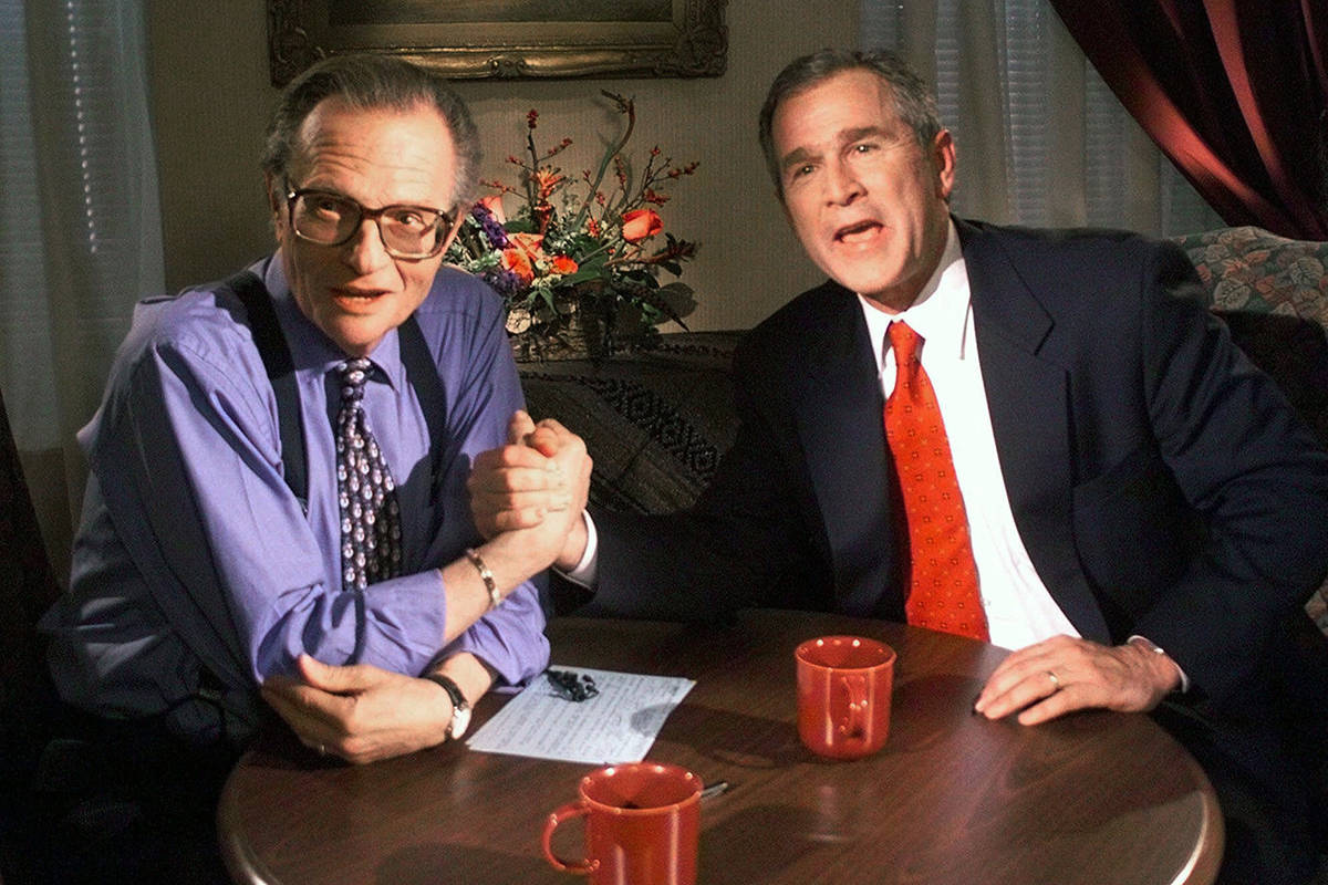"FILE - In this Dec. 16, 1999 file photo, Republican presidential candidate Texas Gov. George W. Bush jokes with CNN's Larry King after finishing the ""Larry King Live"" show from the Wildhorse Saloon in Nashville, Tenn. King, who interviewed presidents, movie stars and ordinary Joes during a half-century in broadcasting, has died at age 87. Ora Media, the studio and network he co-founded, tweeted that King died Saturday, Jan. 23, 2021 morning at Cedars-Sinai Medical Center in Los Angeles. (AP Photo/John Russell, file)"