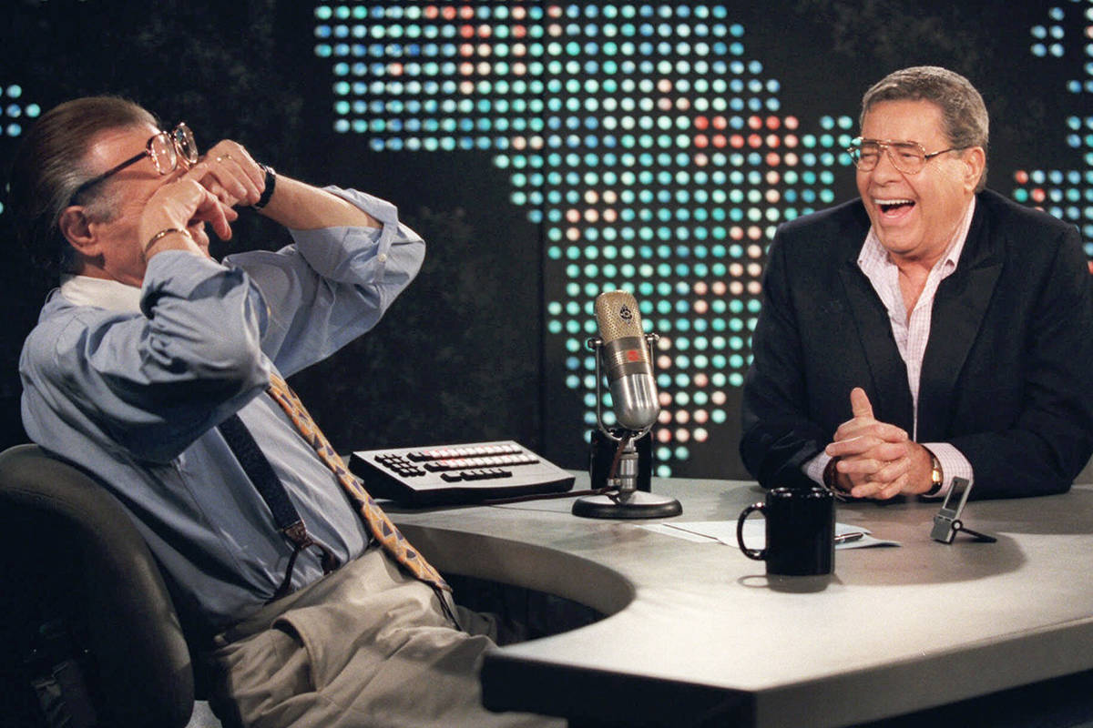 "FILE - In this Thursday, Aug. 26, 1999, file photo, talk show host Larry King wipes his eyes after laughing at a joke by comedy legend Jerry Lewis, on the set of ""Larry King Live"" at CNN Studios in the Hollywood section of Los Angeles. King, who interviewed presidents, movie stars and ordinary Joes during a half-century in broadcasting, has died at age 87. Ora Media, the studio and network he co-founded, tweeted that King died Saturday, Jan. 23, 2021 morning at Cedars-Sinai Medical Center in Los Angeles. (AP Photo/Chris Pizzello, File)"