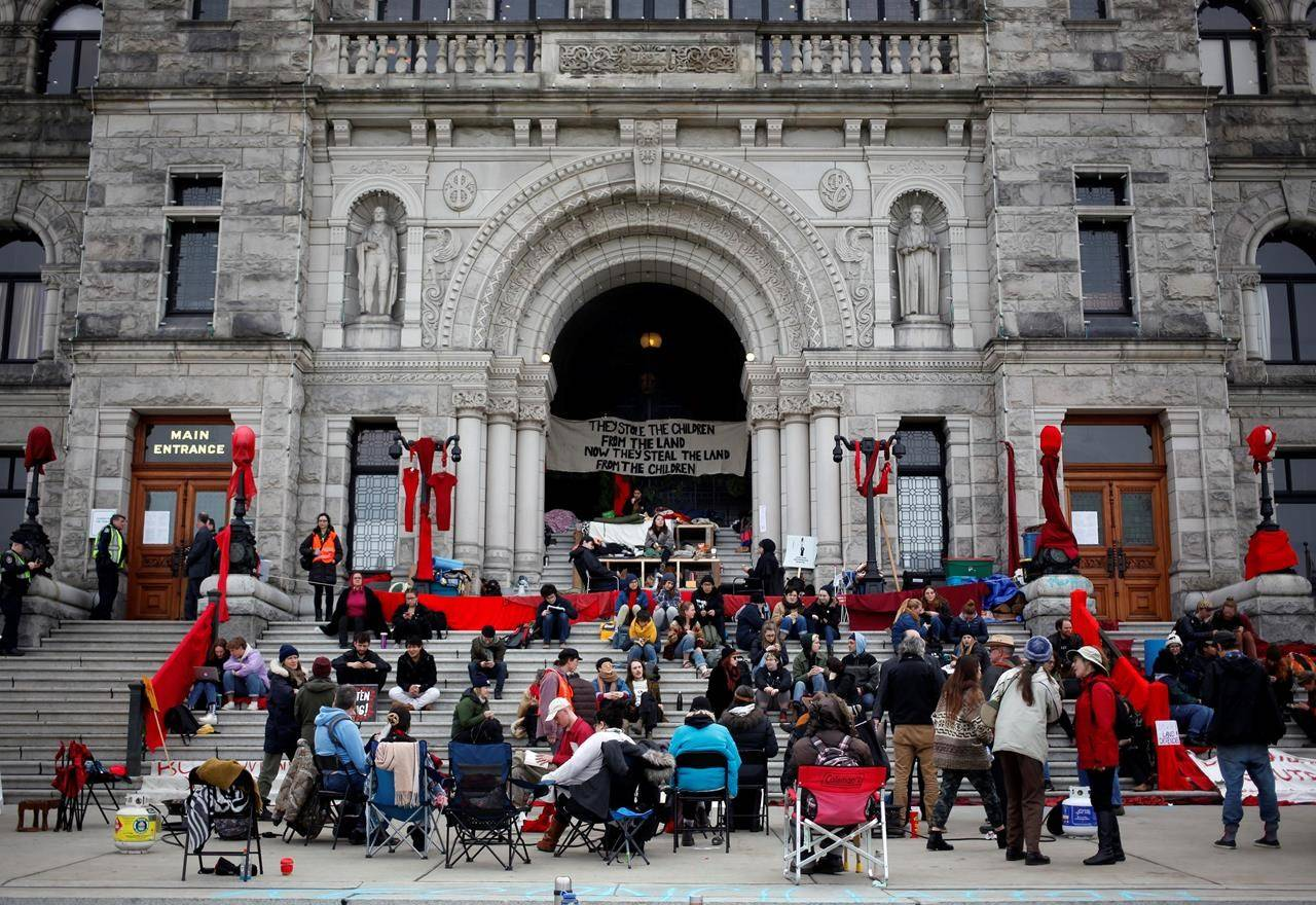 Wet'suwet'en supporters and Coastal GasLink opponents continue to protest outside the B.C. Legislature in Victoria, B.C., on Thursday, February 27, 2020. THE CANADIAN PRESS/Chad Hipolito