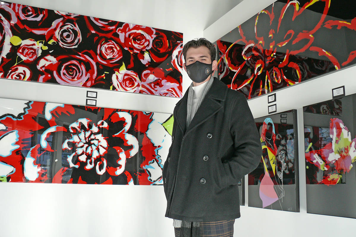 Luke Eddie Stripp, seen with with some of his paintings at his just-opened art gallery in Langley City in January 2020 (Dan Ferguson/Langley Advance Times)