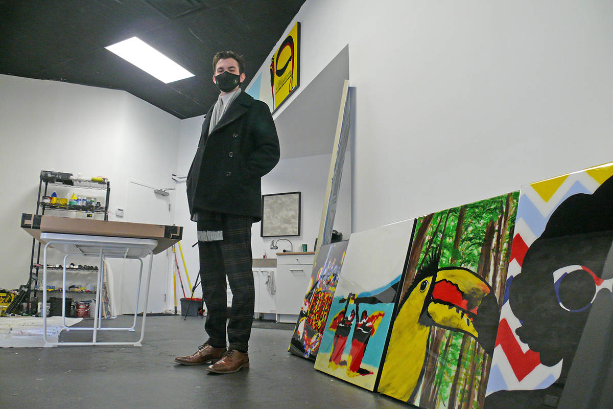 Luke Eddie Stripp, seen with with some of his paintings at his just-opened art gallery in Langley City (Dan Ferguson/Langley Advance Times)