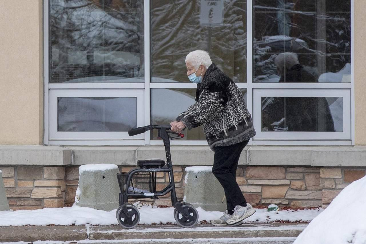 A woman walks outside the Roberta Place Long Term Care home in Barrie, Ont. on Monday, January 18, 2021. The devastating toll of COVID-19 on long-term care residents in Canada has underscored the need for increased public funding for home care, advocates say. THE CANADIAN PRESS/Frank Gunn