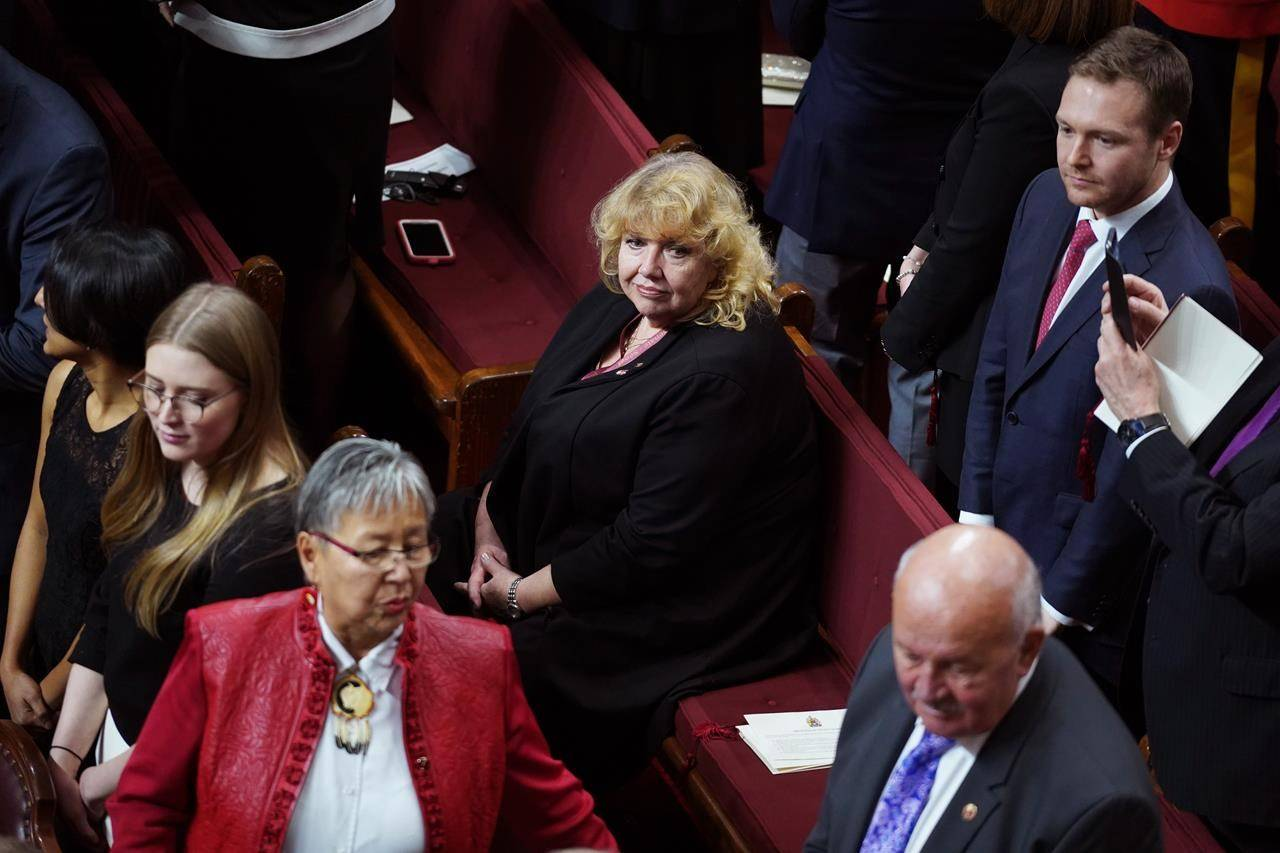 Sen. Lynn Beyak waits for the throne speech in the Senate chamber in Ottawa, Thursday, Dec. 5, 2019. Beyak is retiring from the Senate three years early. THE CANADIAN PRESS/Chris Wattie