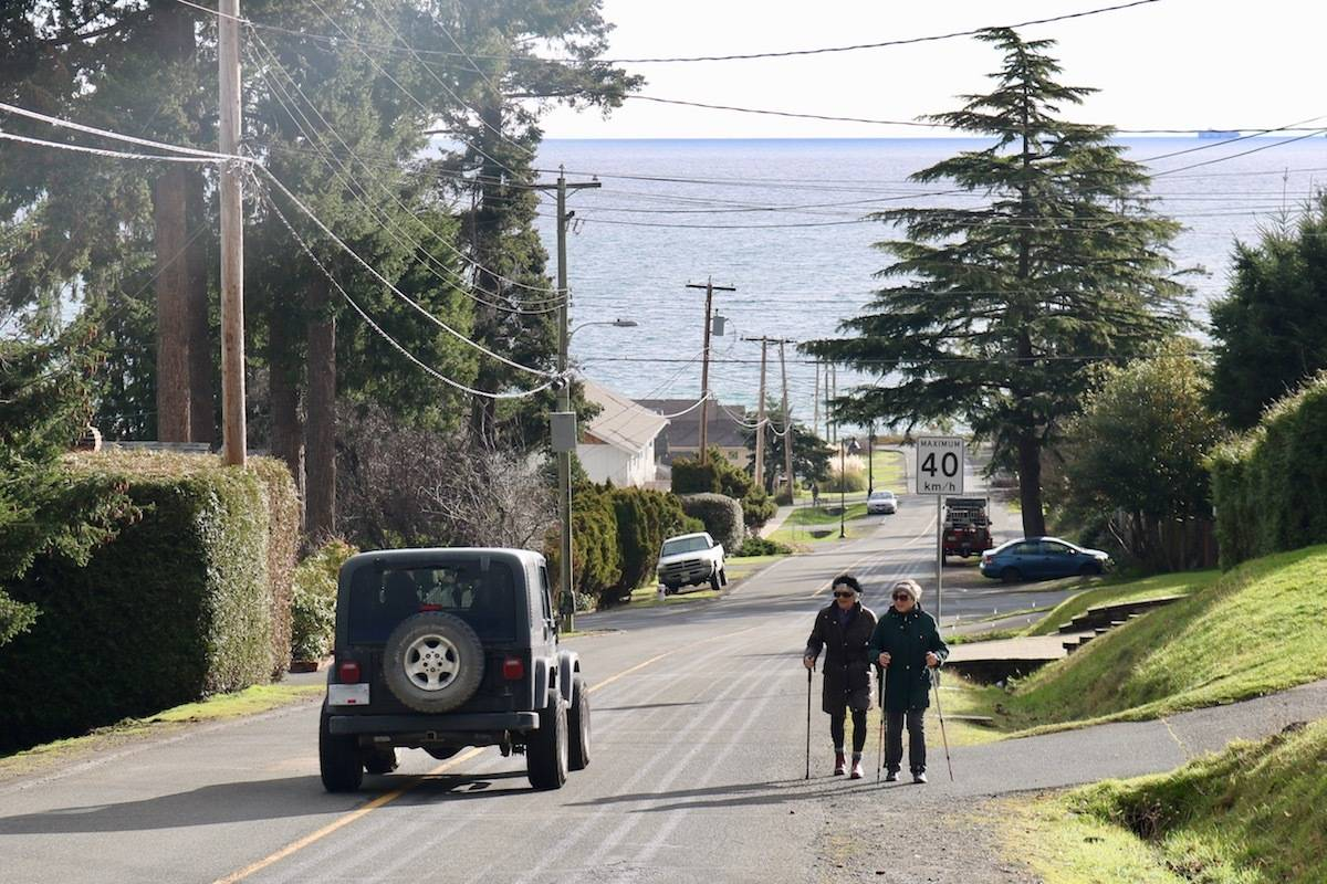 Brad Windsor pointed out that the space between pedestrians and vehicles along Milburn Drive is too small. He has chosen to start driving his daughter to school instead of walking, in fear of her own safety. (Aaron Guillen/News Staff)