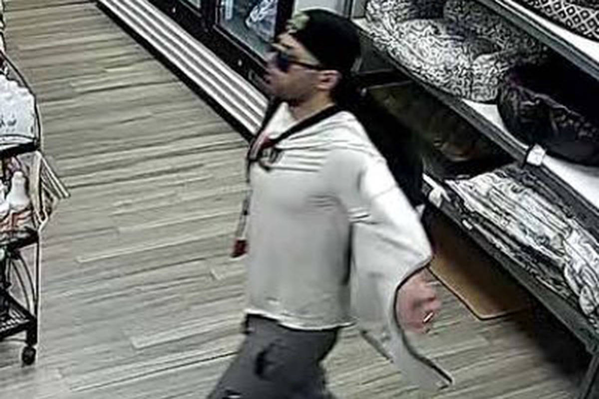 This suspect allegedly stole a charity donation jar from a Langley store in November. (Langley RCMP/Special to the Langley RCMP)