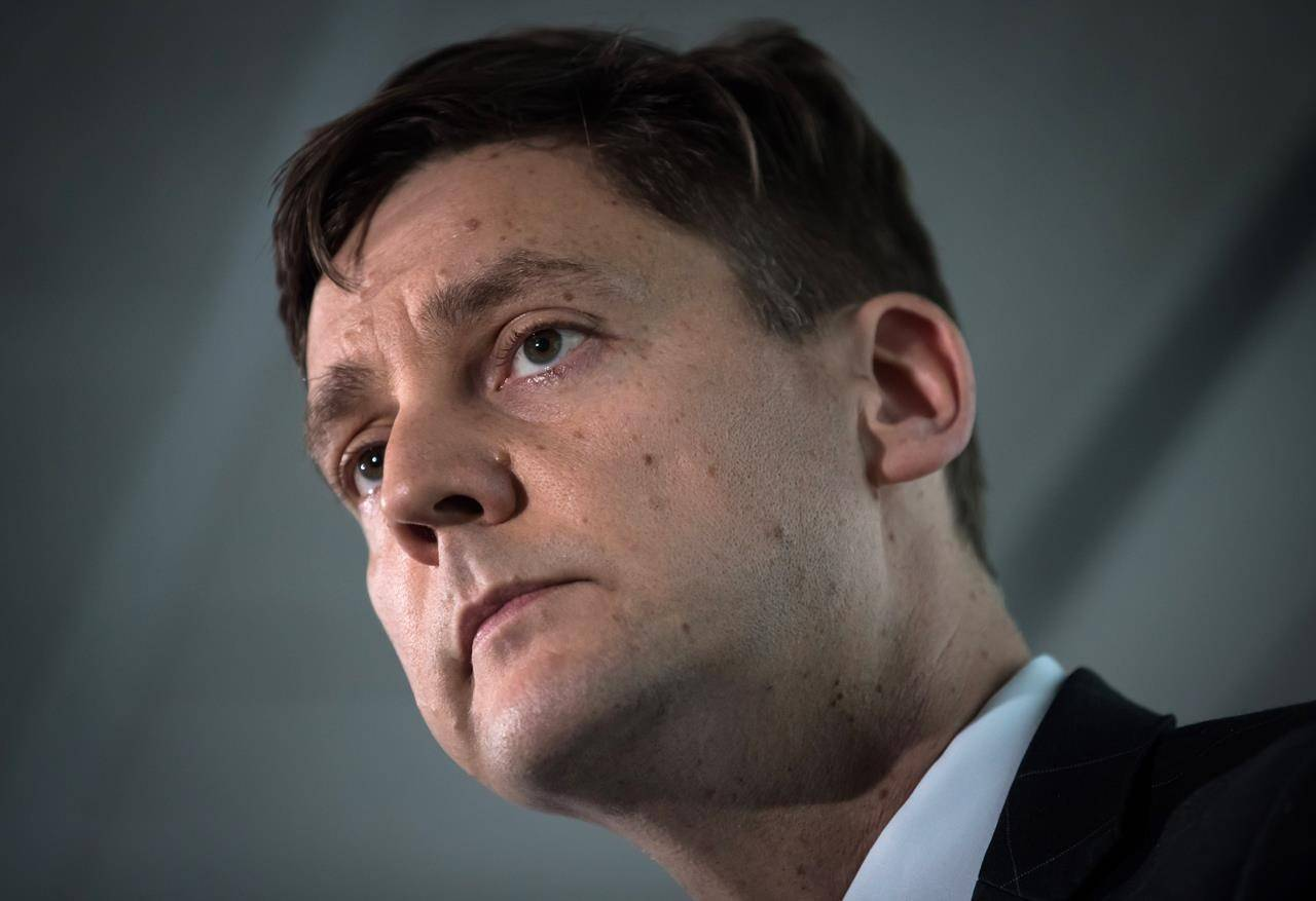 """British Columbia Attorney General David Eby listens during a news conference in Vancouver on Friday May 24, 2019. A former top anti-money laundering official at the British Columbia Lottery Corp. says Eby appeared """"disinterested"""" in the Crown corporation's efforts to monitor and report on possible illegal activities at casinos. THE CANADIAN PRESS/Darryl Dyck"""