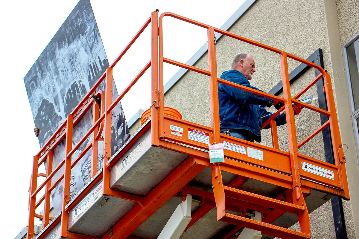 Crews install four new student-made murals on the front of Aldergrove Community Secondary School. (Langley School District/Special to The Aldergrove Star)