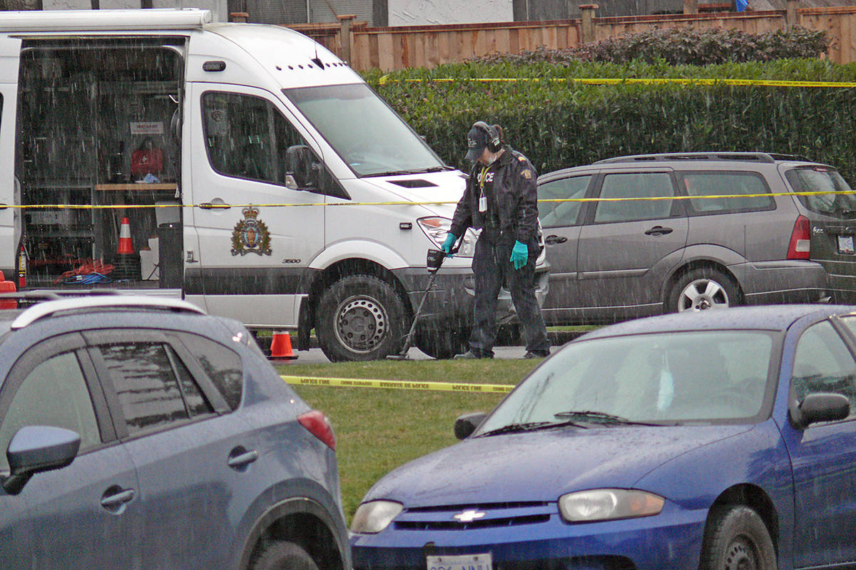 An investigator on the scene of a shooting in Langley City on Wednesday, Jan. 27 (Dan Ferguson/Langley Advance Times)