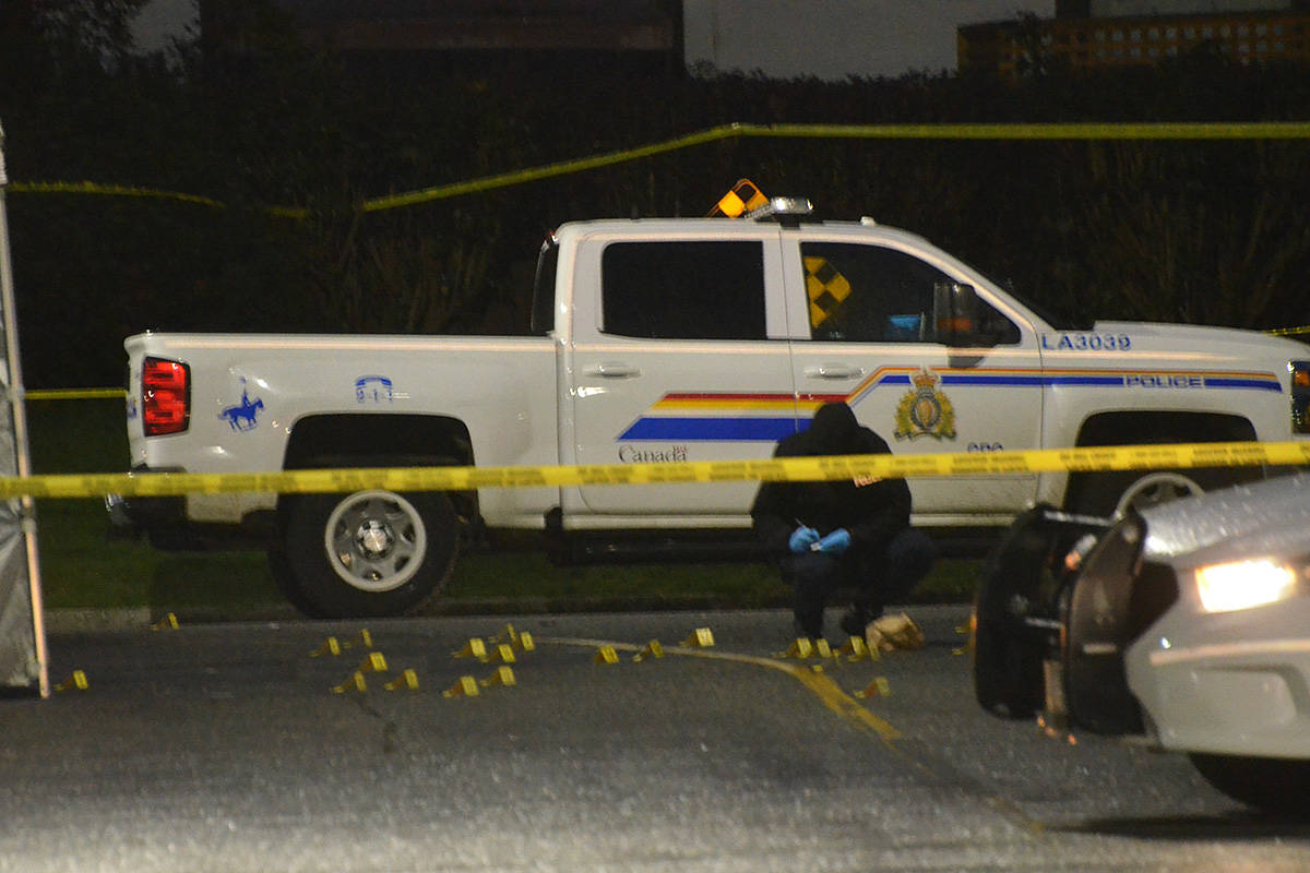 Investigators placed dozens of yellow evidence markers on the ground near the site of a fatal shooting in Langley City early Wednesday morning. (Matthew Claxton/Langley Advance Times)