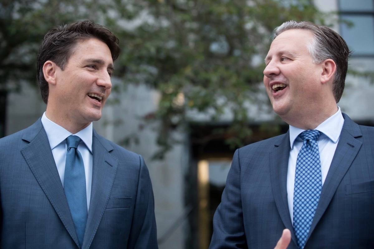 Prime Minister Justin Trudeau, left, and Vancouver Mayor Kennedy Stewart share a laugh while speaking to the media before sitting down for a meeting at City Hall, in Vancouver, on Friday August 30, 2019. (THE CANADIAN PRESS/Darryl Dyck)
