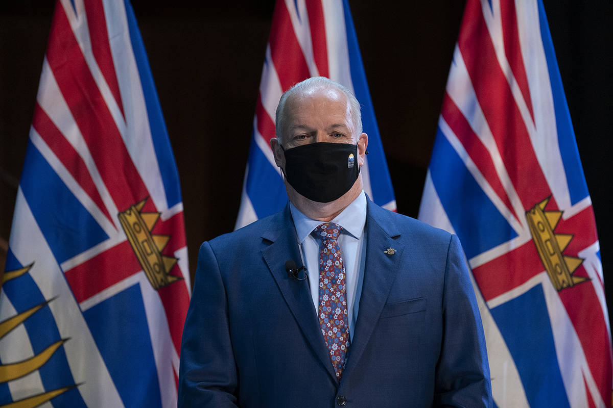 B.C. Premier John Horgan wears a protective face mask to help prevent the spread of COVID-19 prior to being sworn in by The Honourable Janet Austin, Lieutenant Governor of British Columbia during a virtual swearing in ceremony in Victoria, Thursday, November 26, 2020. THE CANADIAN PRESS/Jonathan Hayward