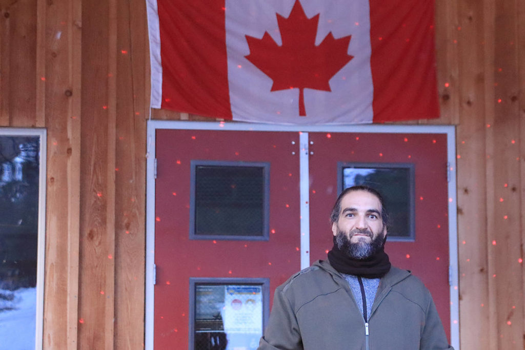 "Othman ""Adam"" Hamdan, pictured in front of Christina Lake's Welcome Centre, was acquitted of terrorism related charges in 2017. He has been living in Christina Lake since November 2020. Photo: Laurie Tritschler"