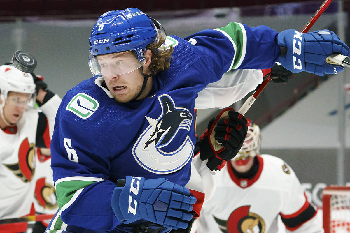 Vancouver Canucks right wing Brock Boeser (6) keeps his eye on the puck during second period NHL action against the Ottawa Senators in Vancouver, Wednesday, Jan. 27, 2021. THE CANADIAN PRESS/Jonathan Hayward