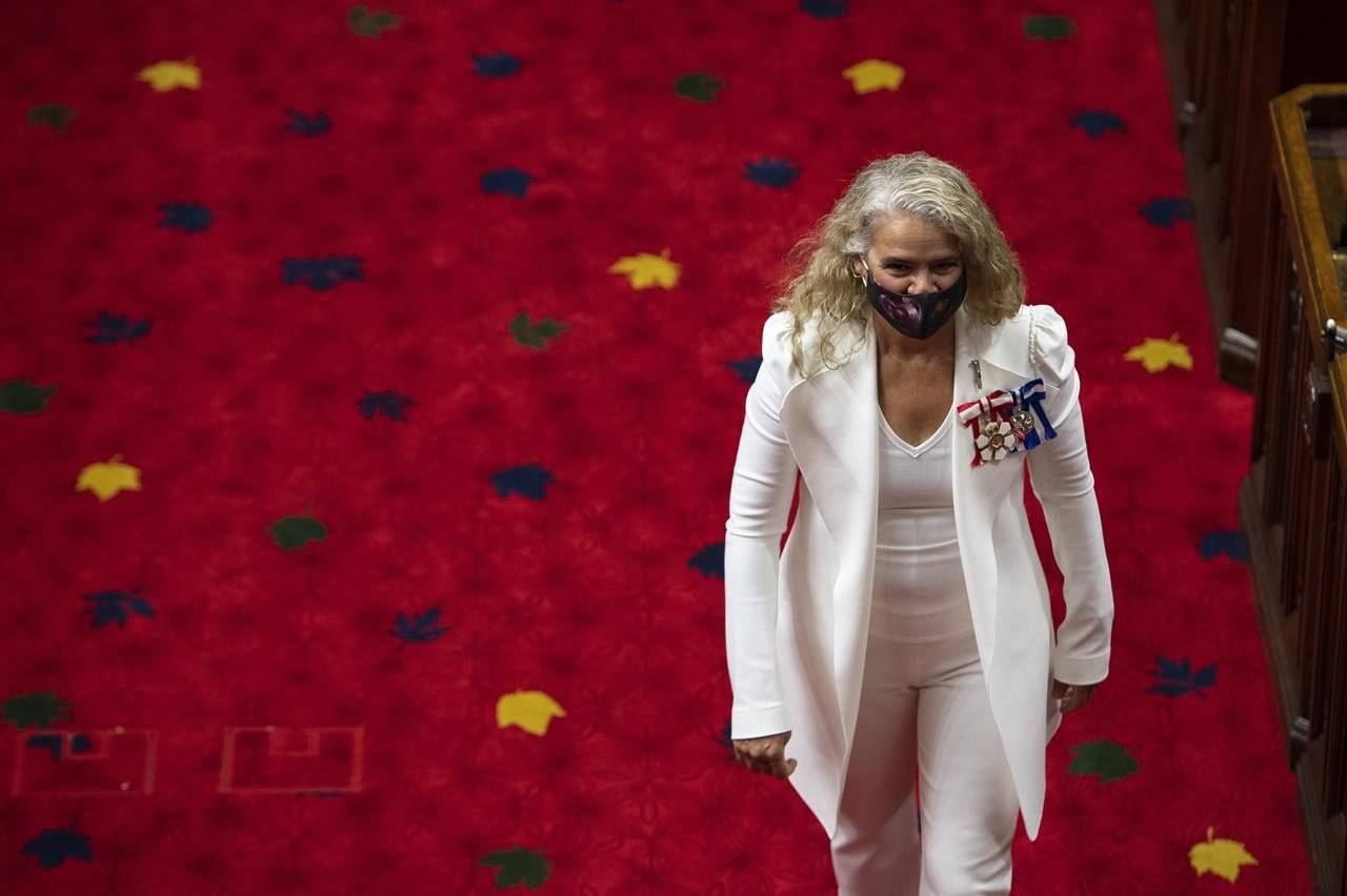 Gov.Gen Julie Payette walks in the chamber after greeting Senators before delivering the Speech from the Throne, at the Senate of Canada Building in Ottawa, on Wednesday, Sept. 23, 2020. THE CANADIAN PRESS/Justin Tang