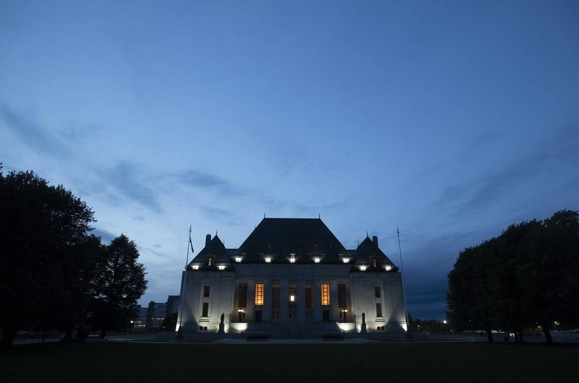 The Supreme Court of Canada is seen at sunset in Ottawa on September 1, 2020. Canada's top court refused on Thursday to hear a case involving the limits of police oversight, prompting a renewed call for a misconduct hearing against a police officer a Black family accused of brutality. THE CANADIAN PRESS/Adrian Wyld