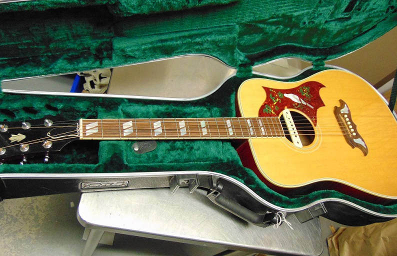 A guitar that was stolen three years ago from the Canadian rock band 54-40 was recovered when RCMP searched a home in Surrey. (RCMP photo)