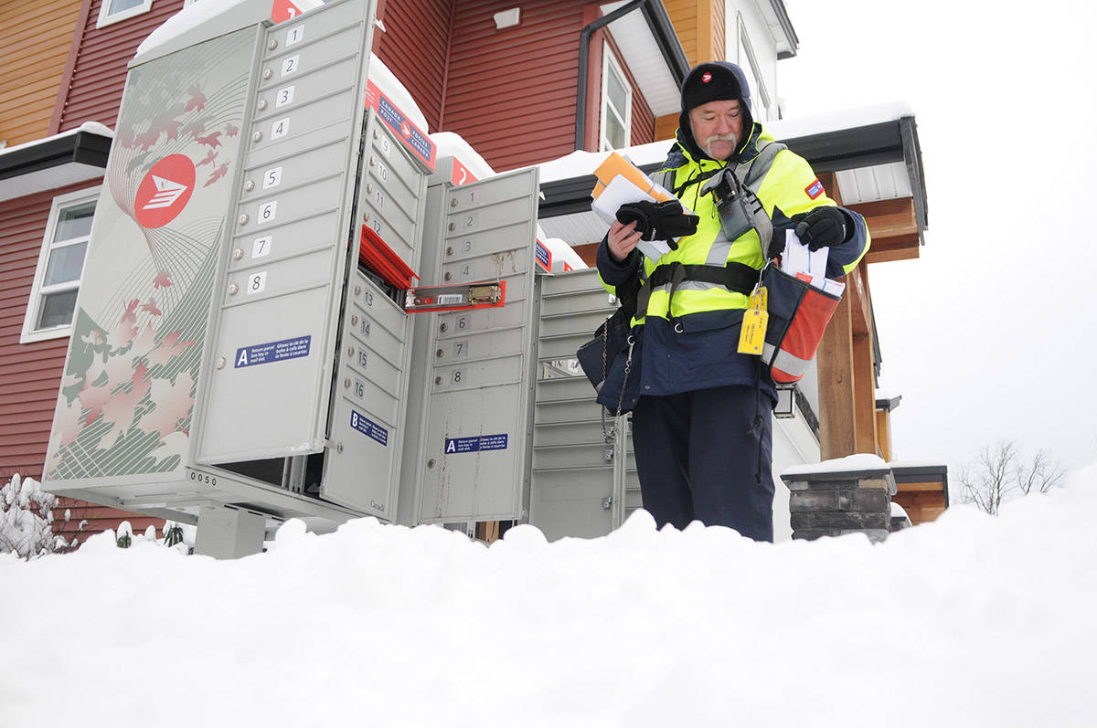 Canada Post carrier, Gary Savard, delivers mail in the snow in Chilliwack on Jan. 13, 2020. Thursday, Feb. 4, 2021 is Thank A Mail Carrier Day. (Jenna Hauck/ Chilliwack Progress file)