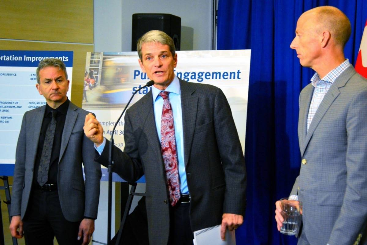 TransLink CEO Kevin Desmond (centre) spoke during conference in New Westminster last year. (Katya Slepian/Black Press)