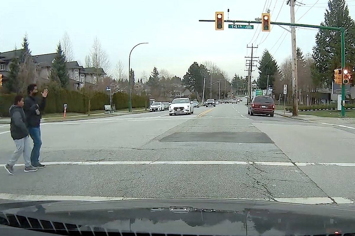 A Dodge Caravan zooms into an intersection against a red light in Burnaby on Jan. 16. Authorities are trying to identify the witnesses who were in the crosswalk at the time. (Burnaby RCMP handout)