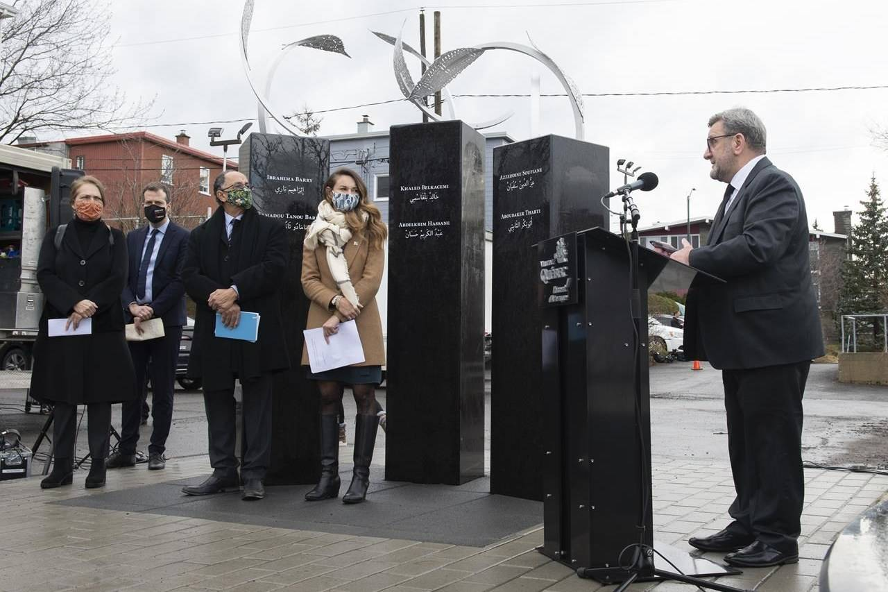 Quebec City mayor Regis Labeaume, right, speaks at the inauguration of a memorial to the 2017 mosque shooting, Tuesday, December 1, 2020 in Quebec City. From the left, Luce Pelletier, artist who designed the memorial, MP Joel Lightbound, Boufeldja Benabdallah, and MNA Joelle Boutin.THE CANADIAN PRESS/Jacques Boissinot