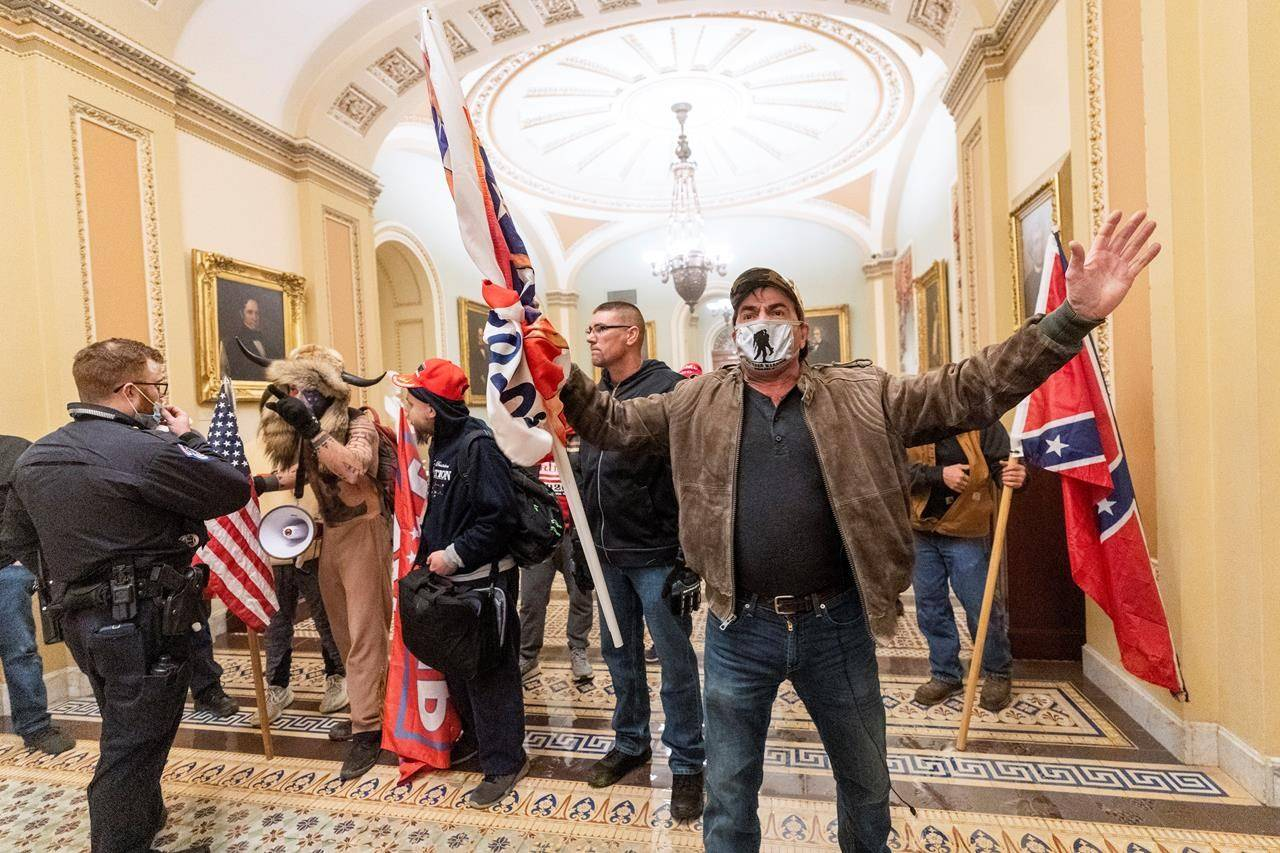 Supporters of President Donald Trump are confronted by U.S. Capitol Police officers outside the Senate Chamber inside the Capitol, in Washington, Wednesday, Jan. 6, 2021. The storming of Capitol Hill in Washington by right-wing extremists earlier this month has spurred calls for Canada to add groups such as the Proud Boys and The Base to its terror list. THE CANADIAN PRESS/AP-Manuel Balce Ceneta