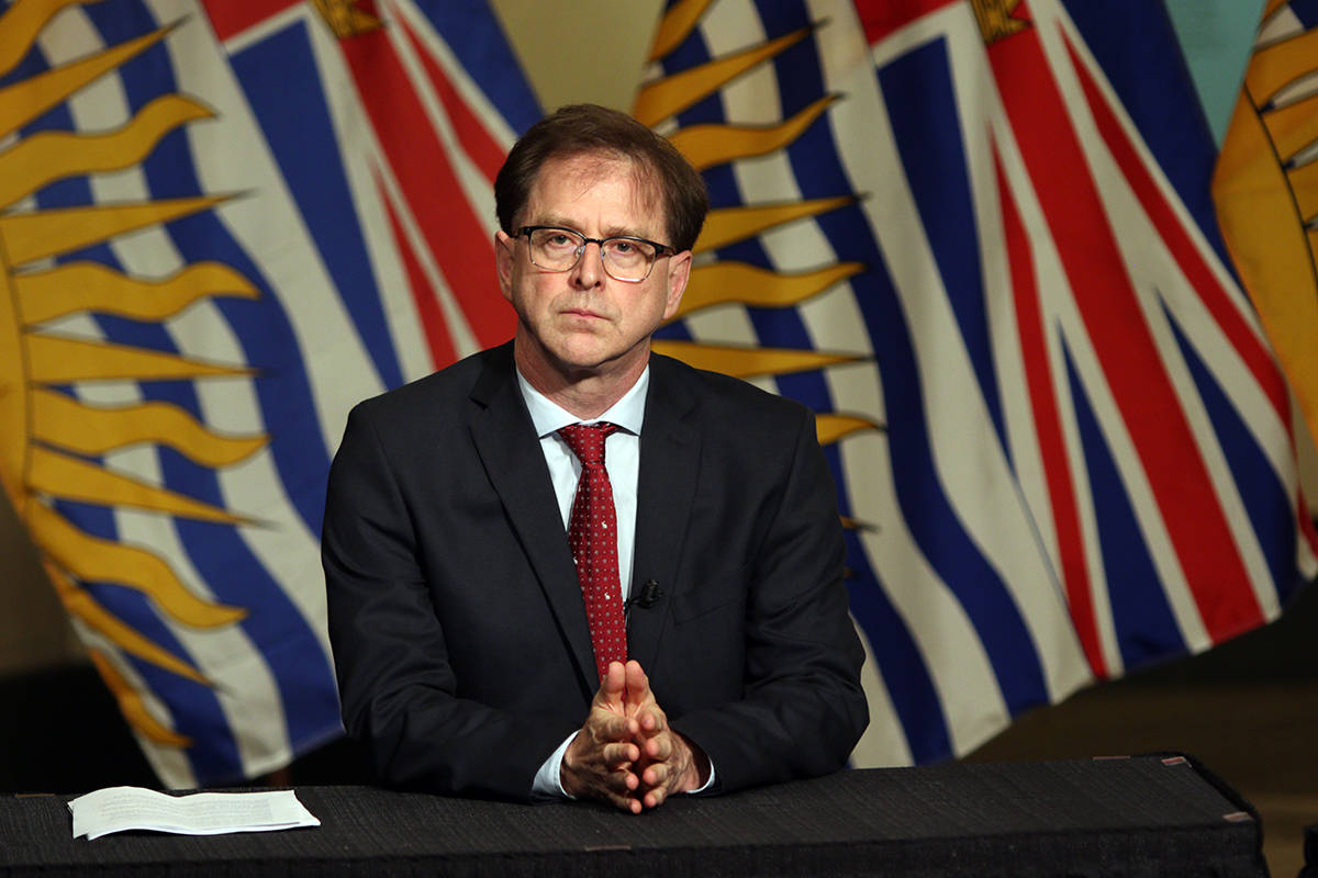 Health Minister Adrian Dix is joined by Provincial Health Officer Dr. Bonnie Henry as they look on as Premier John Horgan discusses reopening the province's economy in phases in response to the COVID-19 pandemic during a press conference in the rotunda at Legislature in Victoria, B.C., on Wednesday May 6, 2020. THE CANADIAN PRESS/Chad Hipolito