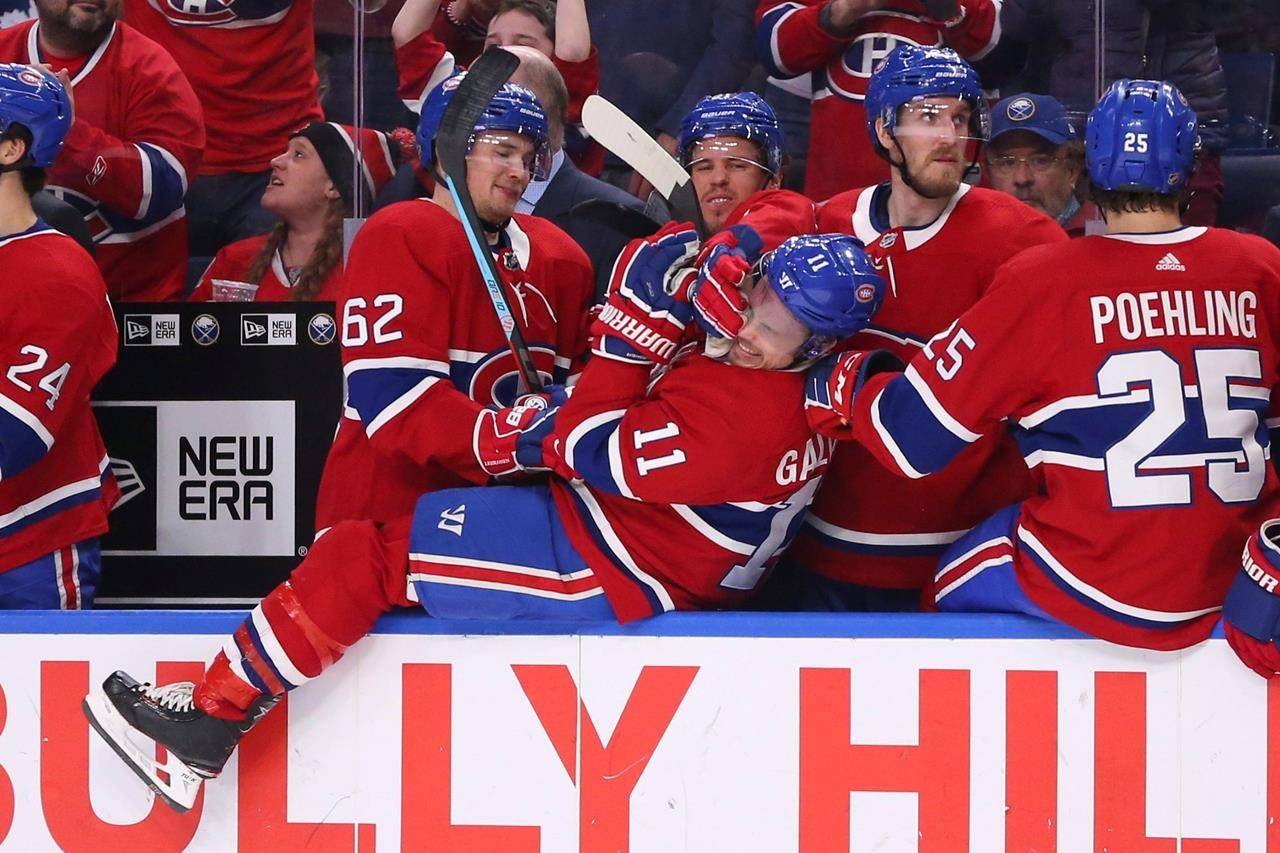 Montreal Canadiens forward Brendan Gallagher (11) and teammates celebrate in the closing moments of the team's 3-1 victory over the Buffalo Sabres in an NHL hockey game in Buffalo, N.Y., on January 30, 2020. THE CANADIAN PRESS/AP, Jeffrey T. Barnes