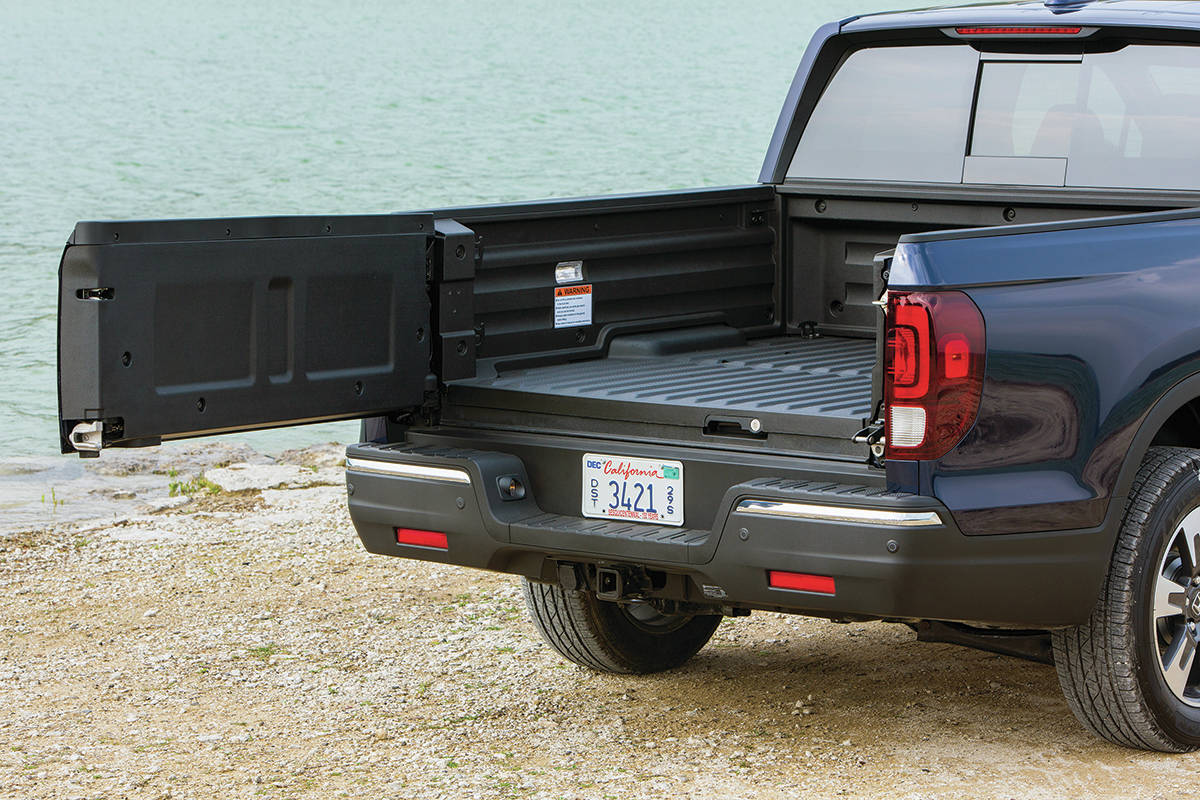 The Ridgeline's tailgate swings out from the right, or it can be dropped down (it can hold 135 kilograms). PHOTO: HONDA