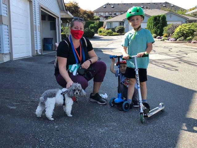 Kate Westlake has been volunteering with ElderDog since July 2020. She and her two sons Braden and Nathan help local seniors by taking their pup Maggie out for a walk. (Christina Saremba/Special to Langley Advance Times)