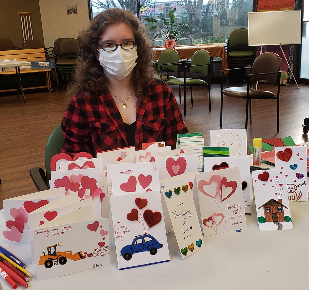 Staffer Melissa shows some of her card creations at the Langley Adult Day Program, which is operated by the Langley Senior Resources Society (Special to Langley Advance Times)