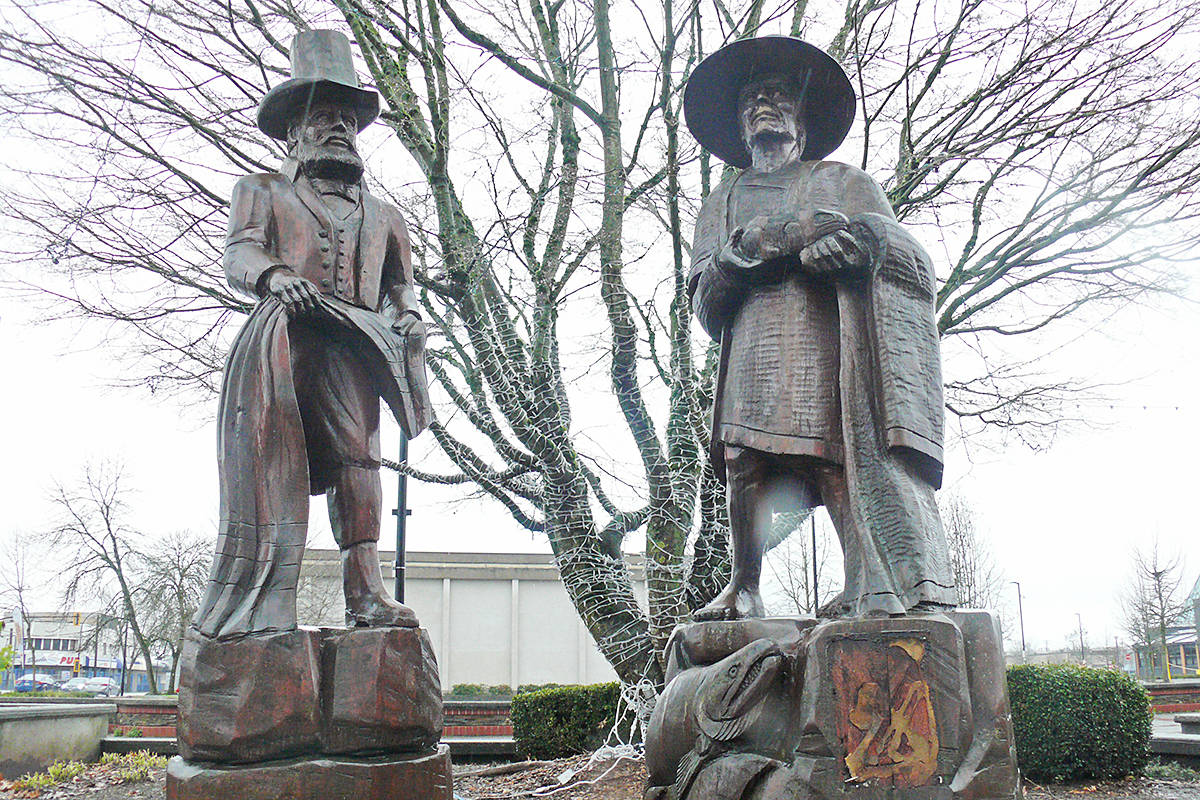 """Two of Steve Ryan's many Langley City statues, """"The Traders,"""" seen on Sunday, Jan. 31, at Innes Corners plaza (Dan Ferguson/Langley Advance Times)"""