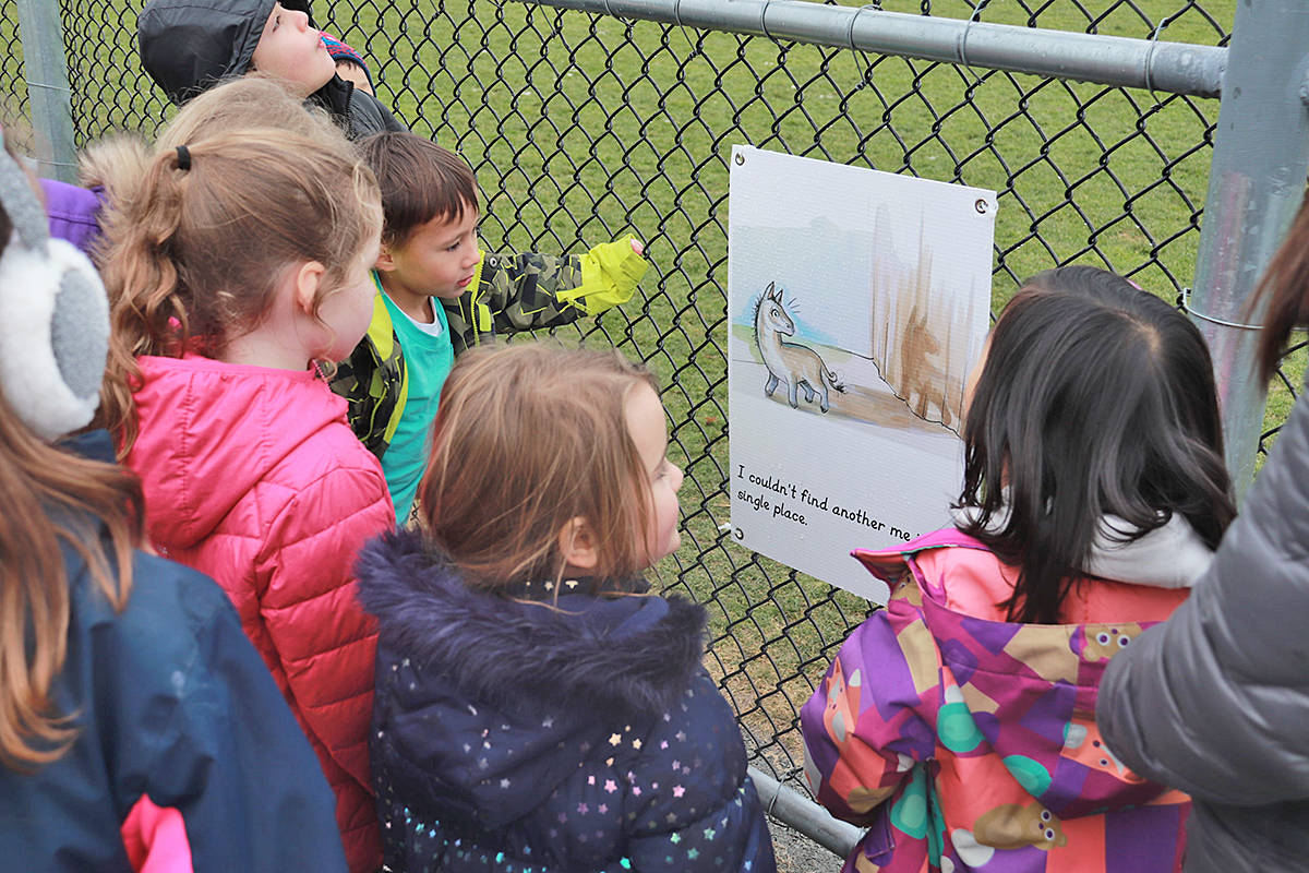 Lynn Fripps Elementary class go on a StoryWalk with Teacher Librarian Jennifer Fernandes during Family Literacy Week. (Special to Langley Advance Times)