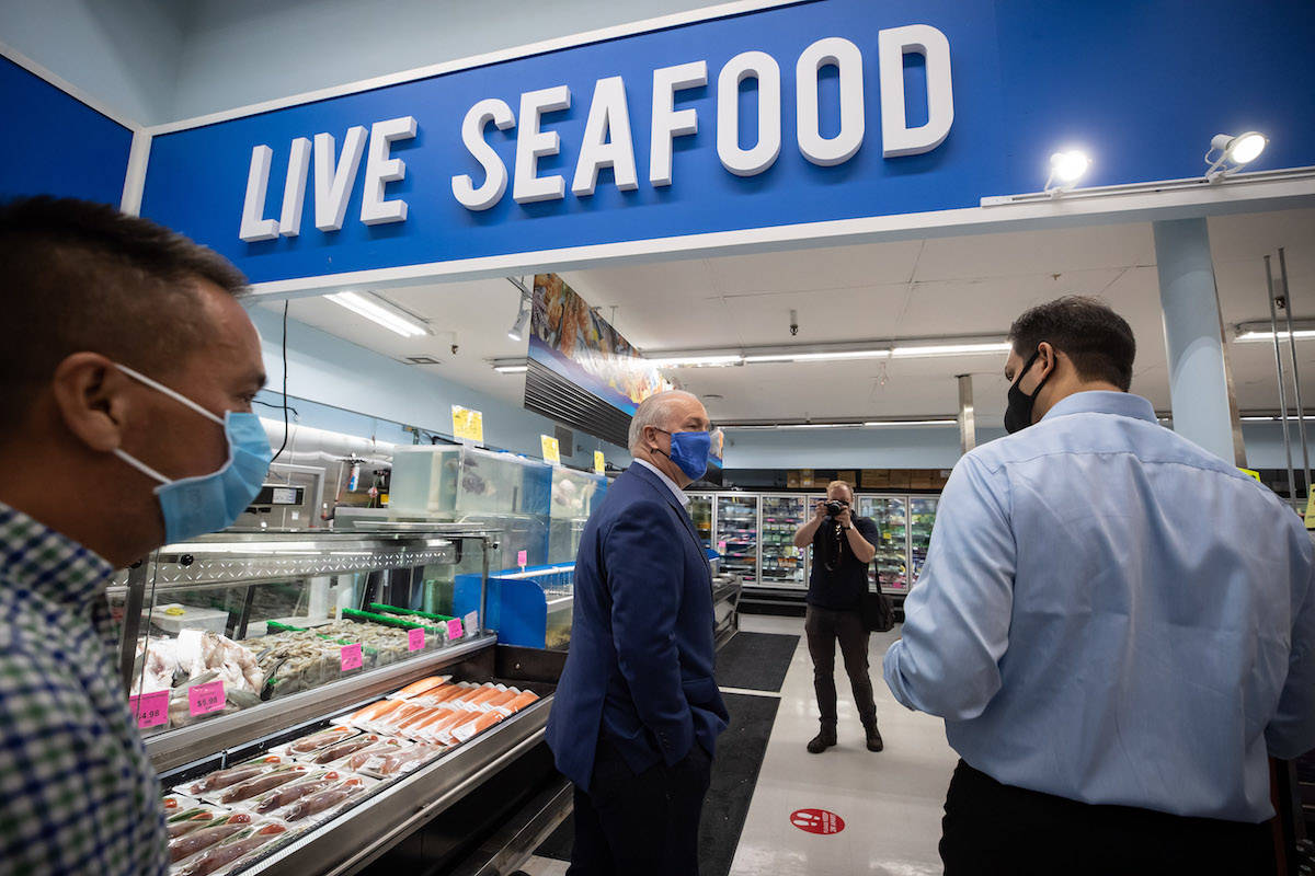 NDP Leader John Horgan is given a tour of the store during a campaign stop at 88 Supermarket in Vancouver, Oct. 1, 2020. THE CANADIAN PRESS/Darryl Dyck