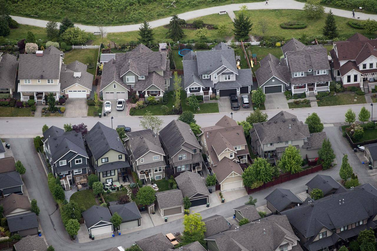 Houses are seen in an aerial view, in Langley, B.C., on Wednesday, May 16, 2018. THE CANADIAN PRESS/Darryl Dyck