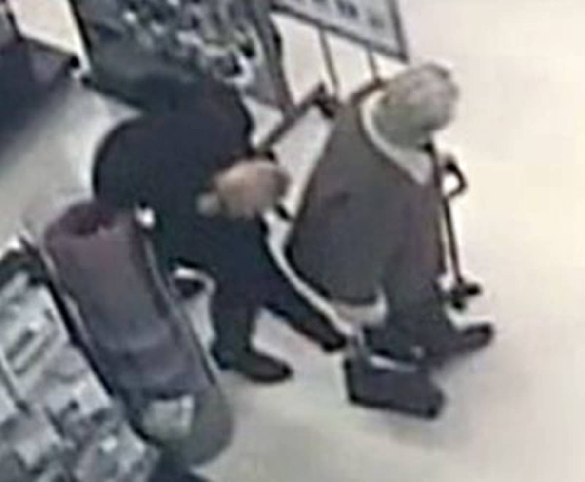 A security camera caught the moment a brazen crook robbed a senior in a Langley store on Jan. 27, then pretended to help them search for it (RCMP/Special to Langley Advance Times)(RCMP)