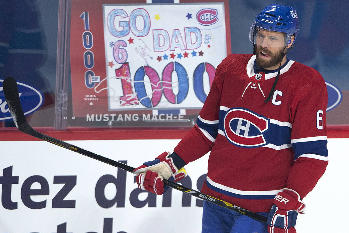Montreal Canadiens defenceman Shea Weber passes by a sign made by his children as he warms up before his 1,000th game of his career for the game against the Vancouver Canucks Tuesday, Feb. 2, 2021 in Montreal. THE CANADIAN PRESS/Ryan Remiorz