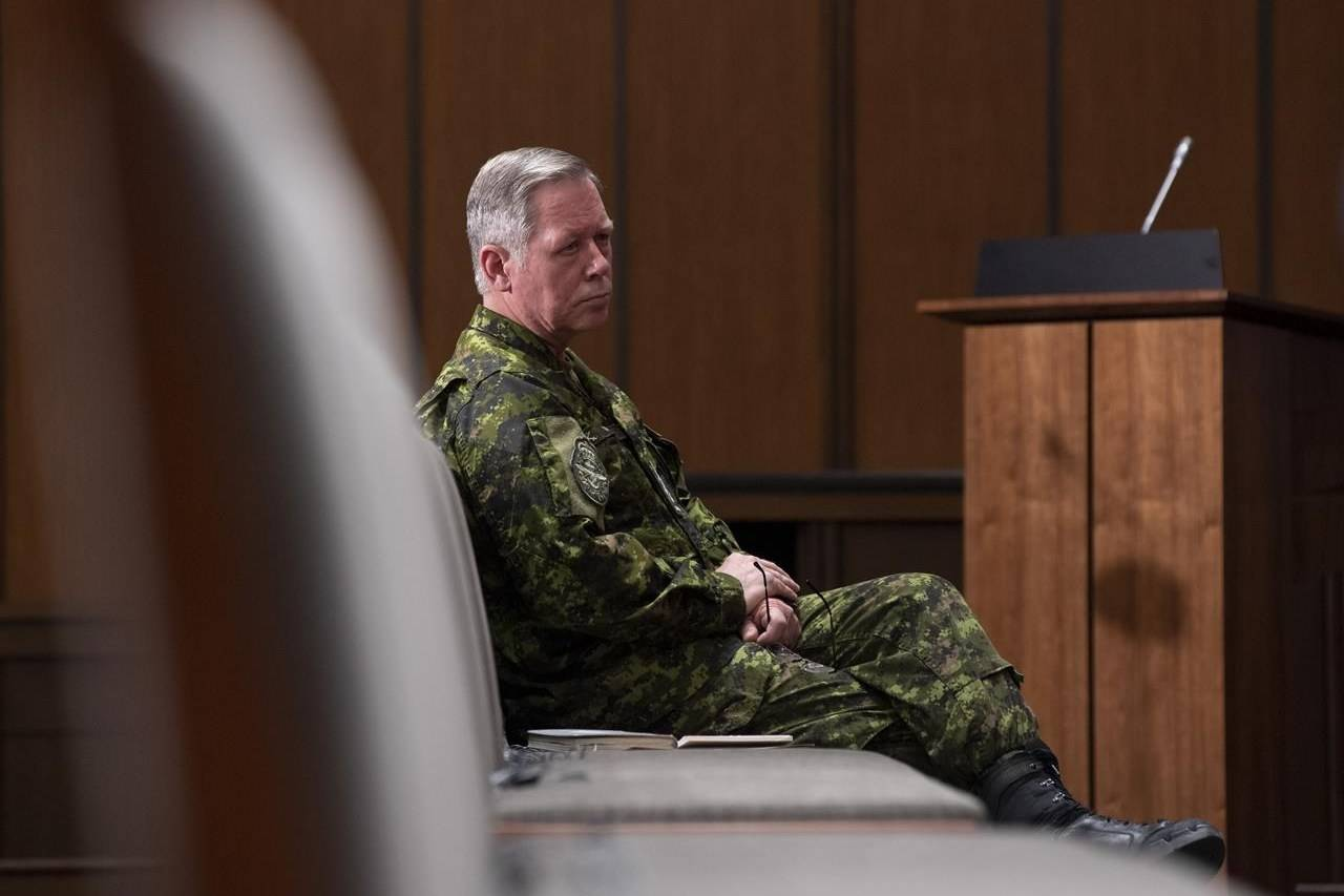 Gen. Jonathan Vance watches a news conference from the front row of seats Thursday May 7, 2020 in Ottawa. THE CANADIAN PRESS/Adrian Wyld