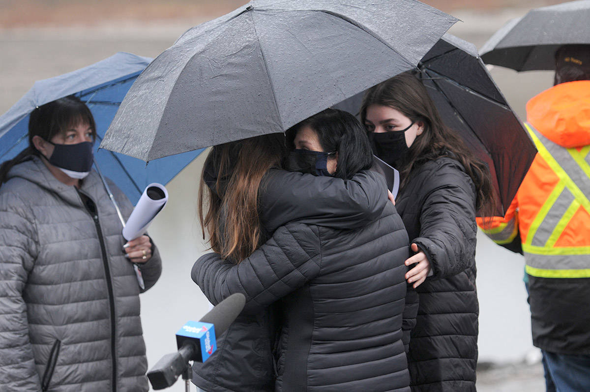 People comfort Alina Durham (centre) after she spoke with media about her missing daughter, Shaelene Bell, on Tuesday, Feb. 2, 2021 on Ballam Road in Chilliwack. (Jenna Hauck/ Chilliwack Progress)