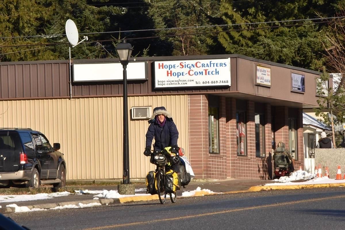 Iliajah Pidskalny rides down Wallace Street in Hope. (Photo/Adam Louis)