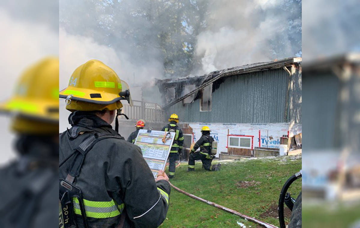 Township firefighters were called to a house fire in the 23300 block of 16 Avenue just before 10 a.m. on Feb. 3, 2021. No one was home at the time of the fire. The cause it not yet known. (Andy Hewitson/Special to Langley Advance Times)