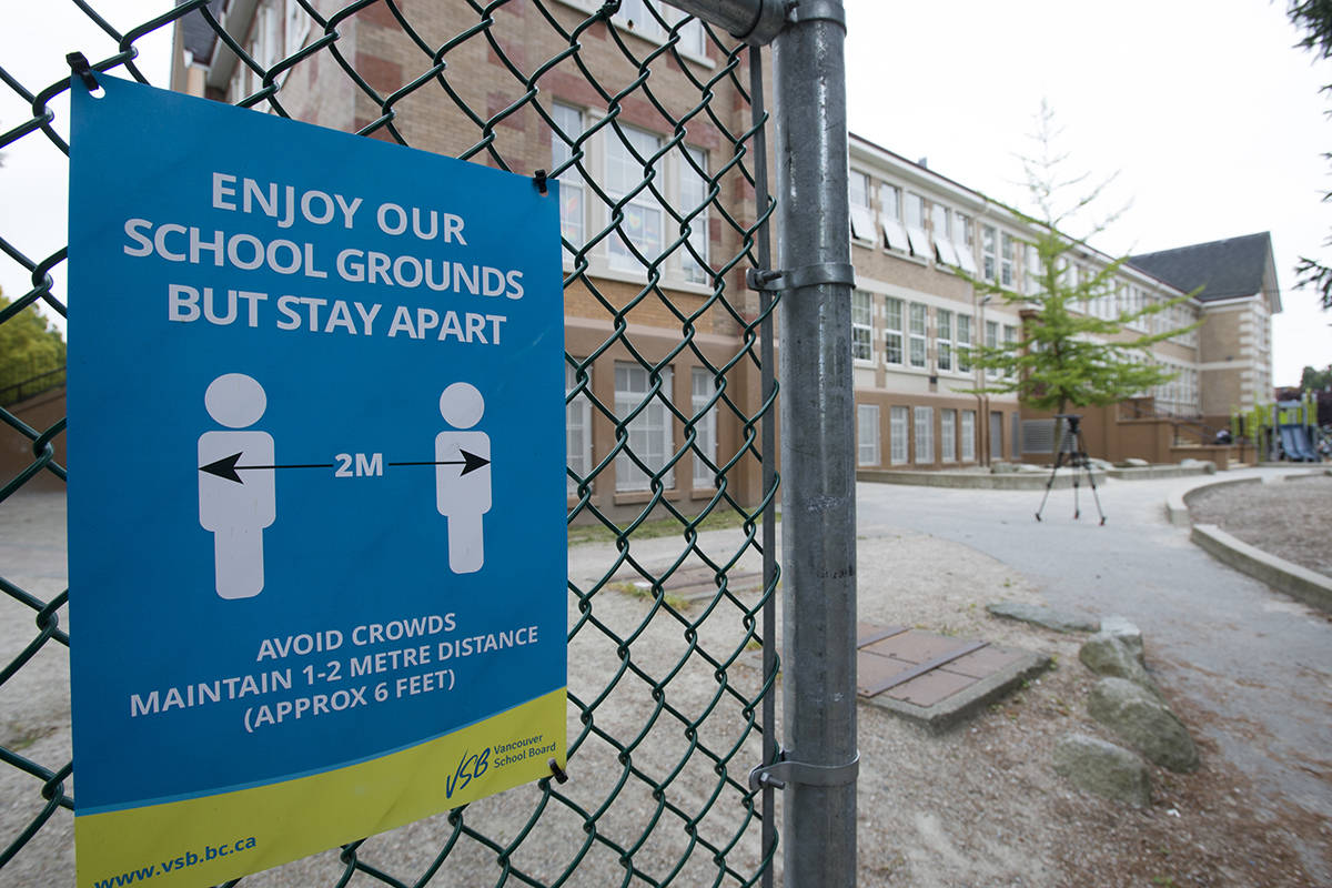 FILE – A physical distancing sign is seen during a media tour of Hastings Elementary school in Vancouver on September 2, 2020. THE CANADIAN PRESS/Jonathan Hayward