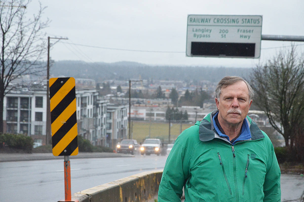 Frank Bucholtz, a Greater Langley Chamber of Commerce director, with one of the electronic signs that are part of the Gateway transportation project. The chamber has lobbied on transit issues for years. (Matthew Claxton/Langley Advance Times)