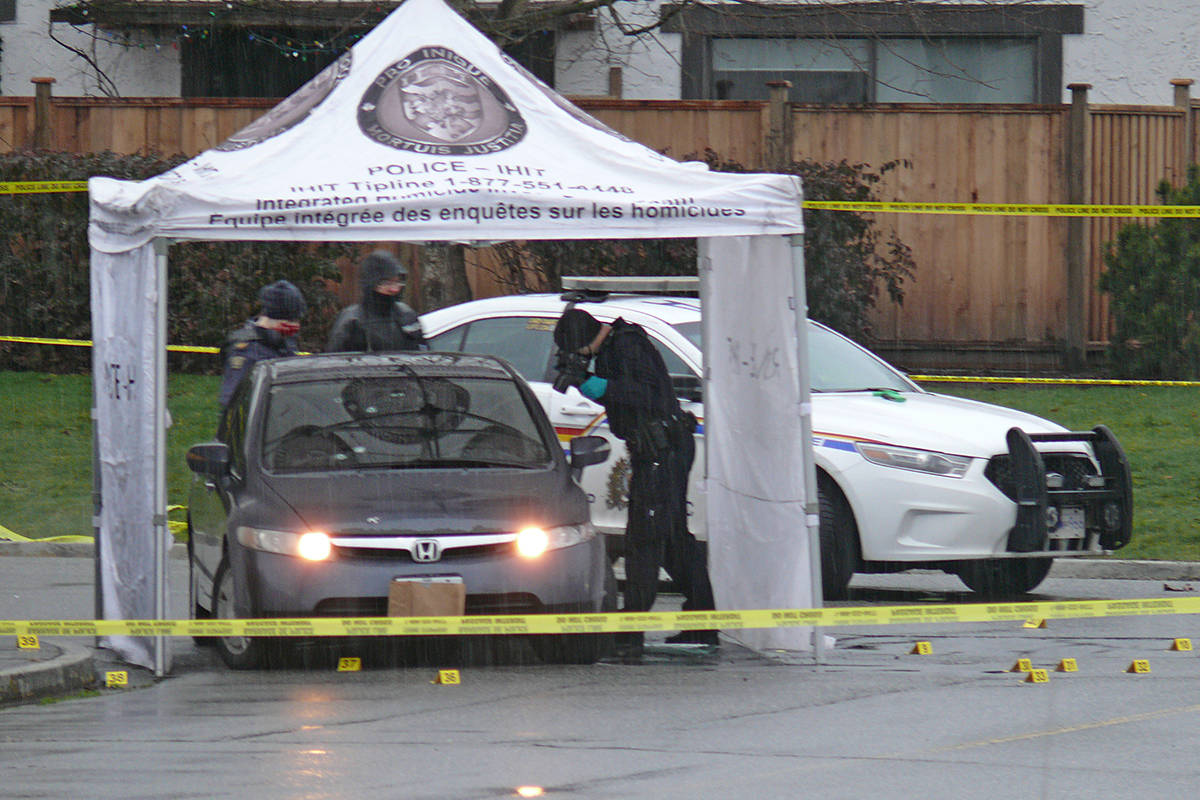 A Honda with what appeared to be bullet holes in the windshield was being examined by police at the scene of a shooting in Langley City on Wednesday, Jan. 27, 2021 (Dan Ferguson/Langley Advance Times)