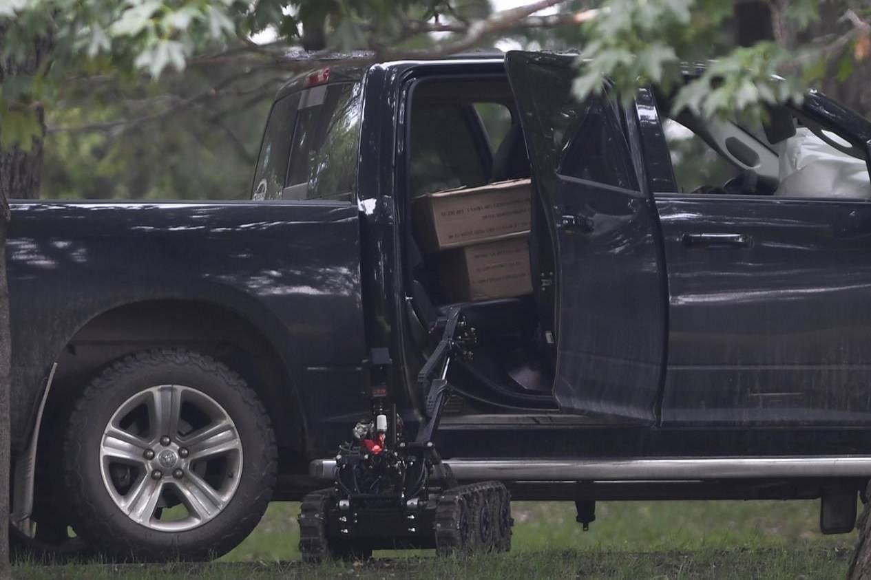 A police robot approaches a pickup truck inside the grounds of Rideau Hall in Ottawa on Thursday, July 2, 2020. nbsp; THE CANADIAN PRESS/Adrian Wyld