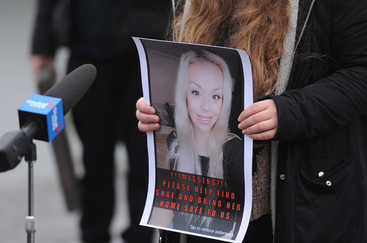 A supporter holds a poster of missing woman, Shaelene Bell, as family speaks with media at the end of McSween Road in Chilliwack on Tuesday, Feb. 2, 2021. (Jenna Hauck/ Chilliwack Progress)