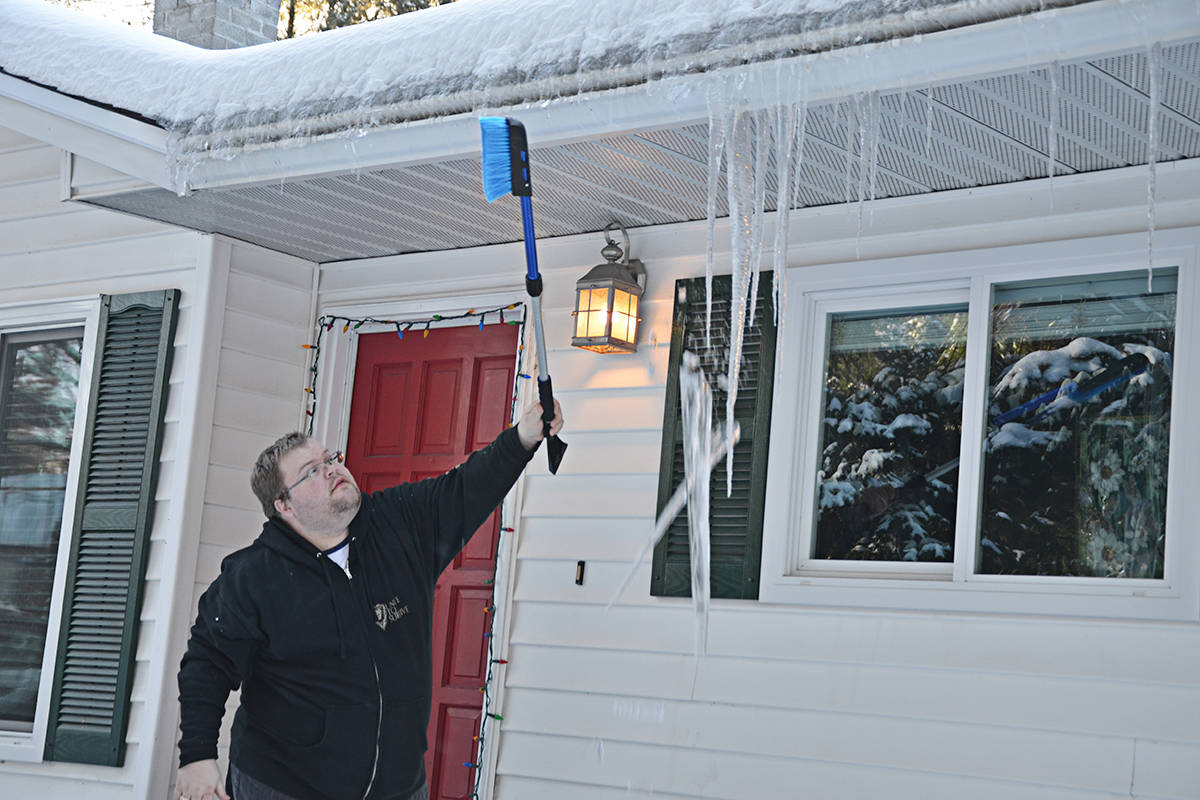 February of 2017 featured a snowstorm that had people busy clearing rooves, walkways and driveways. (Langley Advance Times files)