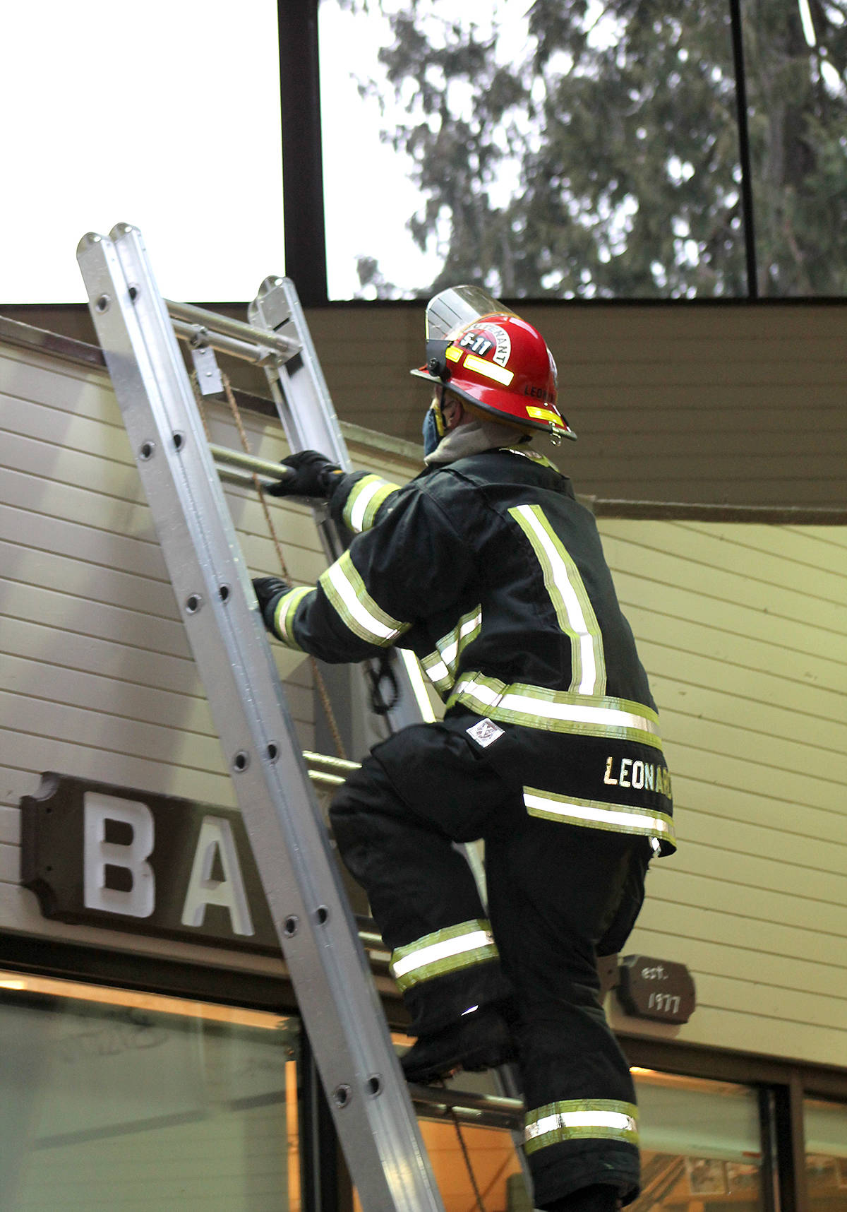 Township firefighters helped evacuate a Brookswood mall Friday afternoon after reports of the smell of fire. (Anngela Bayer/Special to Langley Advance Times)